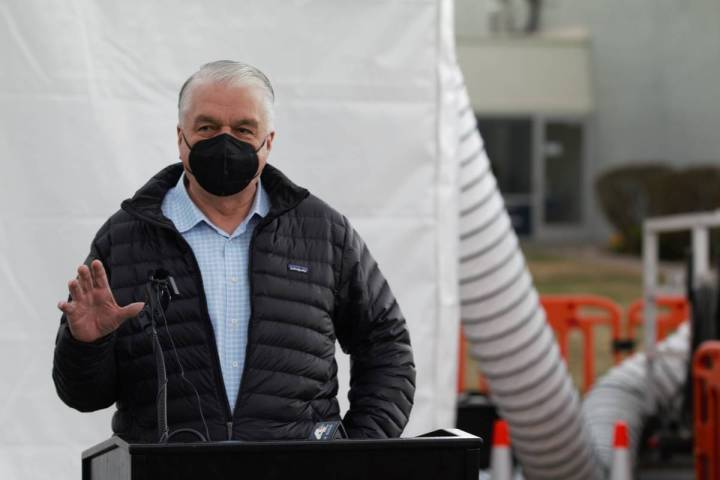 Gov. Steve Sisolak speaks in front of a mobile vaccine unit that was brought into the state by ...