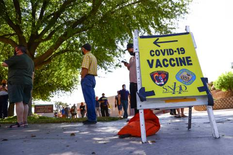 Chase Stevens/Las Vegas Review-Journal People wait in line at the COVID-19 vaccination site at ...