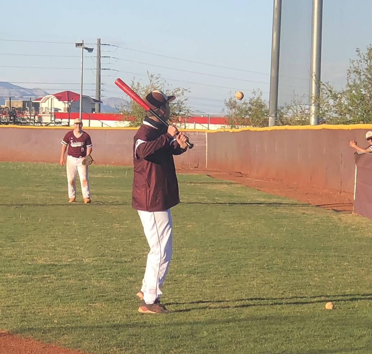 Tom Rysinski/Pahrump Valley Times Assistant baseball coach Drew Middleton hits ground balls to ...