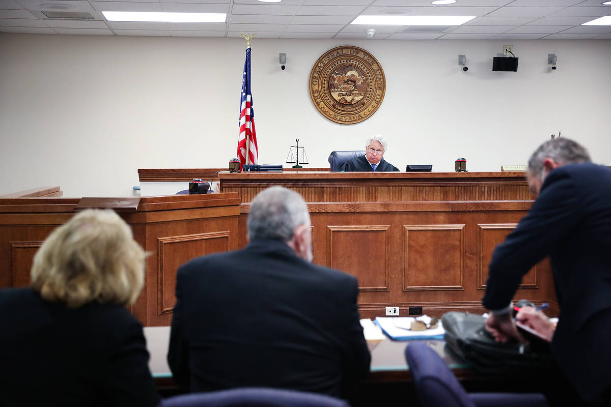 Justice of the Peace Gus Sullivan overseas a brief court hearing for Marcel and Patricia Chappu ...