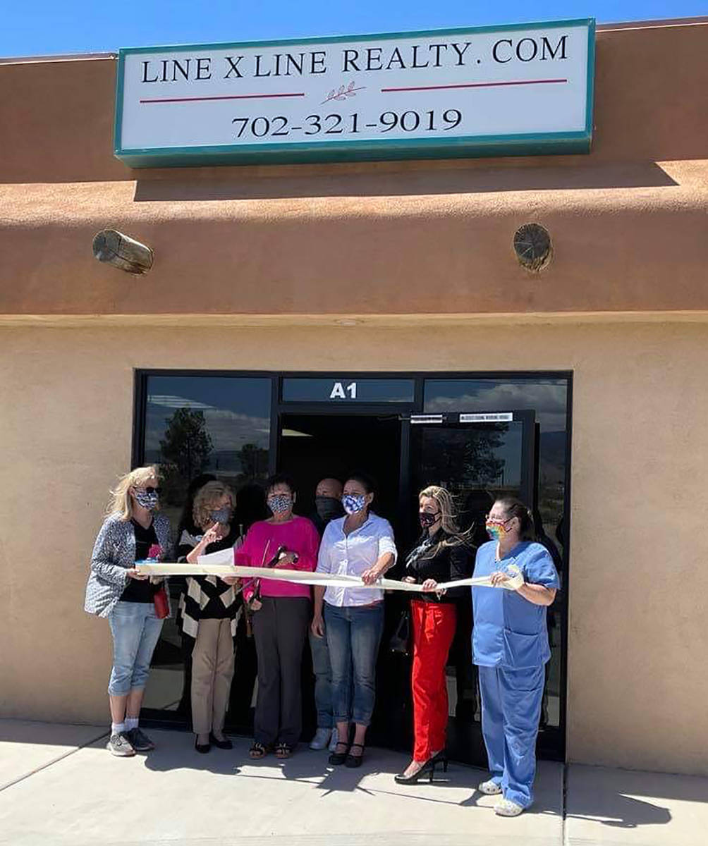 Bianca Graeff/Pahrump Valley Times Pahrump Chamber of Commerce officials and community members ...