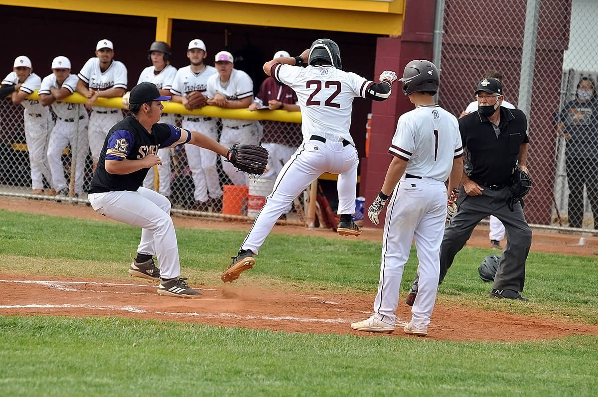 Horace Langford Jr./Pahrump Valley Times Zack Cuellar of Pahrump Valley avoids a tag to score o ...