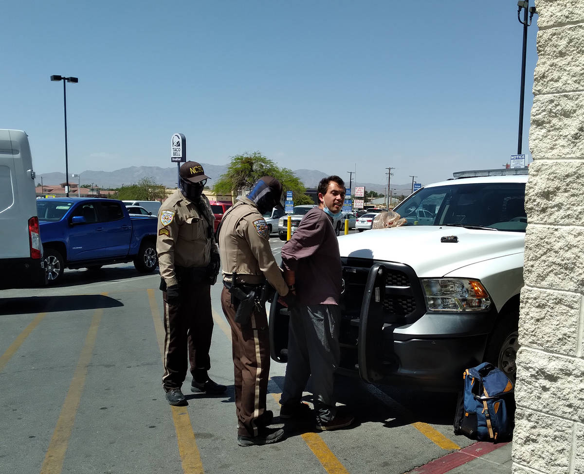 Selwyn Harris/Pahrump Valley Times Nye County Sheriff's Office Deputies secure the arrest of a ...