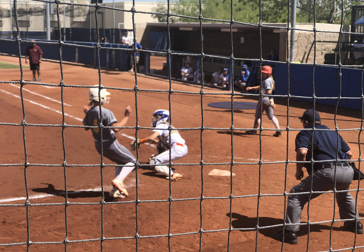 Tom Rysinski/Pahrump Valley Times Lizzie DeAngelis tries to score on a double by Ava Charles du ...