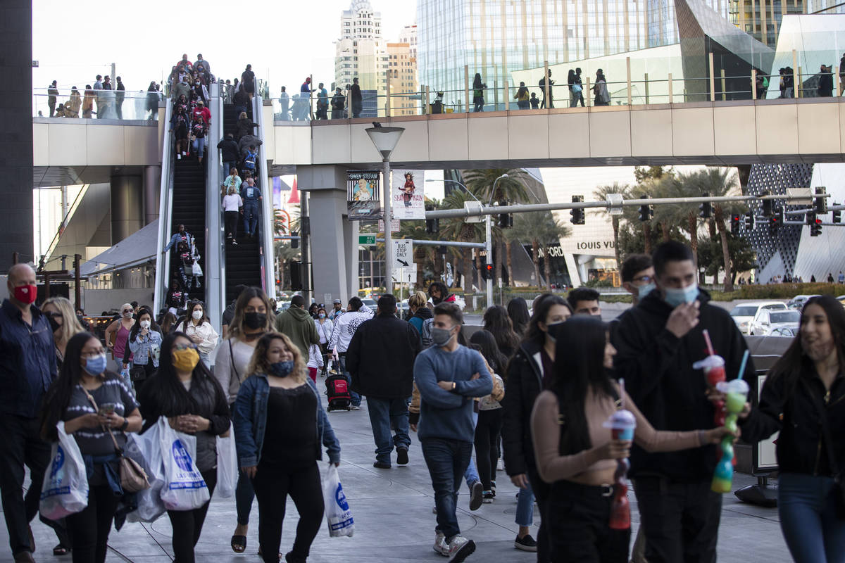 People visit the Strip near the Planet Hollywood hotel-casino in Las Vegas, on Saturday, March ...