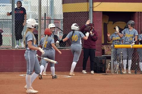 Horace Langford Jr./Pahrump Valley Times Pahrump Valley sophomore Ava Charles (10) is congratul ...