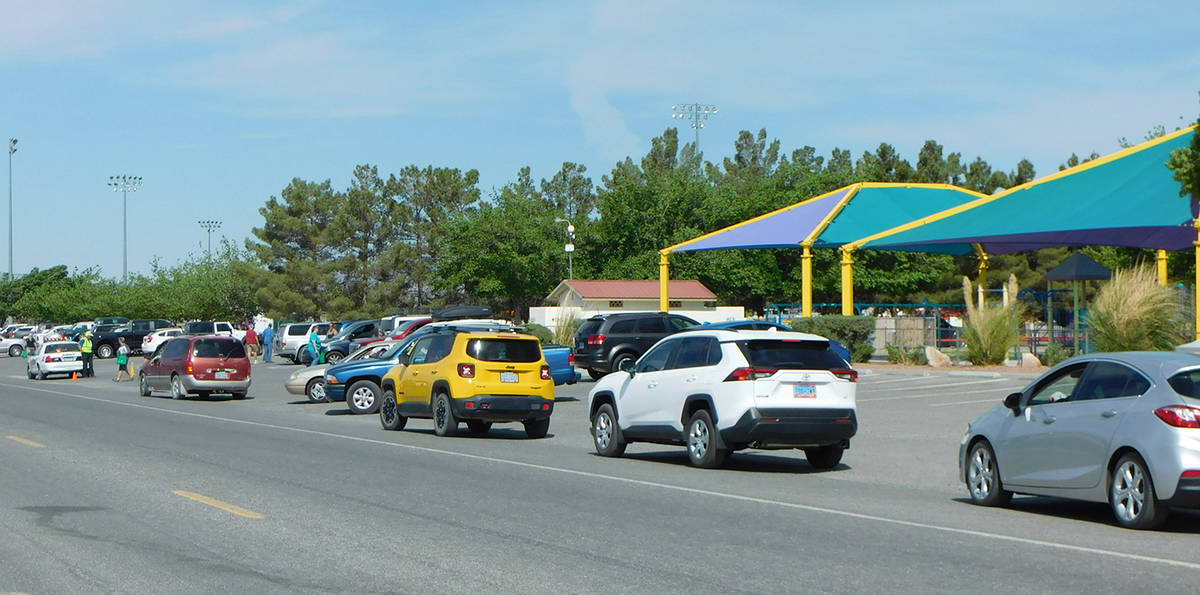 Robin Hebrock/Pahrump Valley Times A long line of cars can be seen waiting their turn to receiv ...
