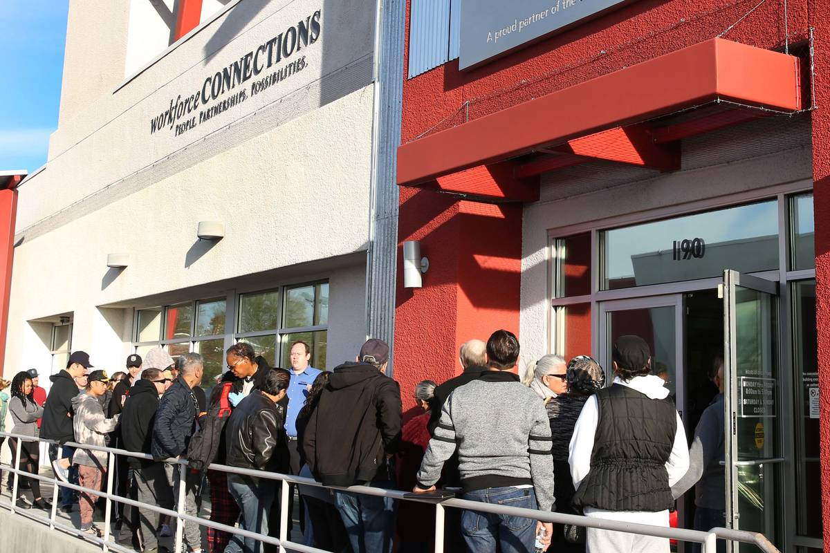 People wait in line at One-Stop Career Center in this March 16, 2020, file photo. (Bizuayehu Te ...