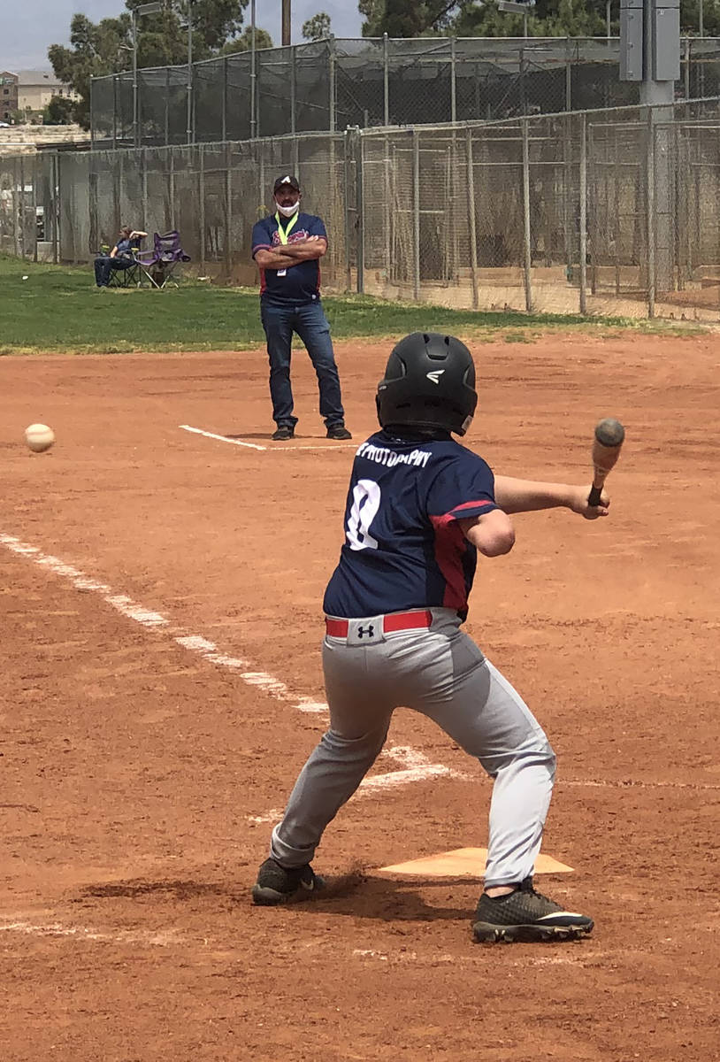 Tom Rysinski/Pahrump Valley Times Eleven-year-old Austin Abelar keeps an eye on the ball as a p ...