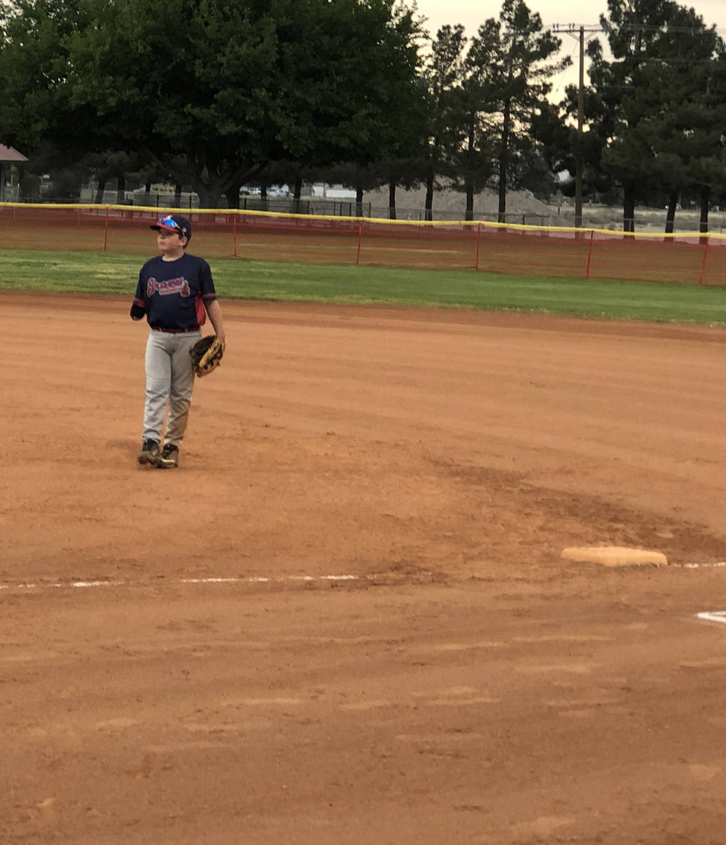 Tom Rysinski/Pahrump Valley Times Austin Abelar stands ready at first base for the Braves durin ...