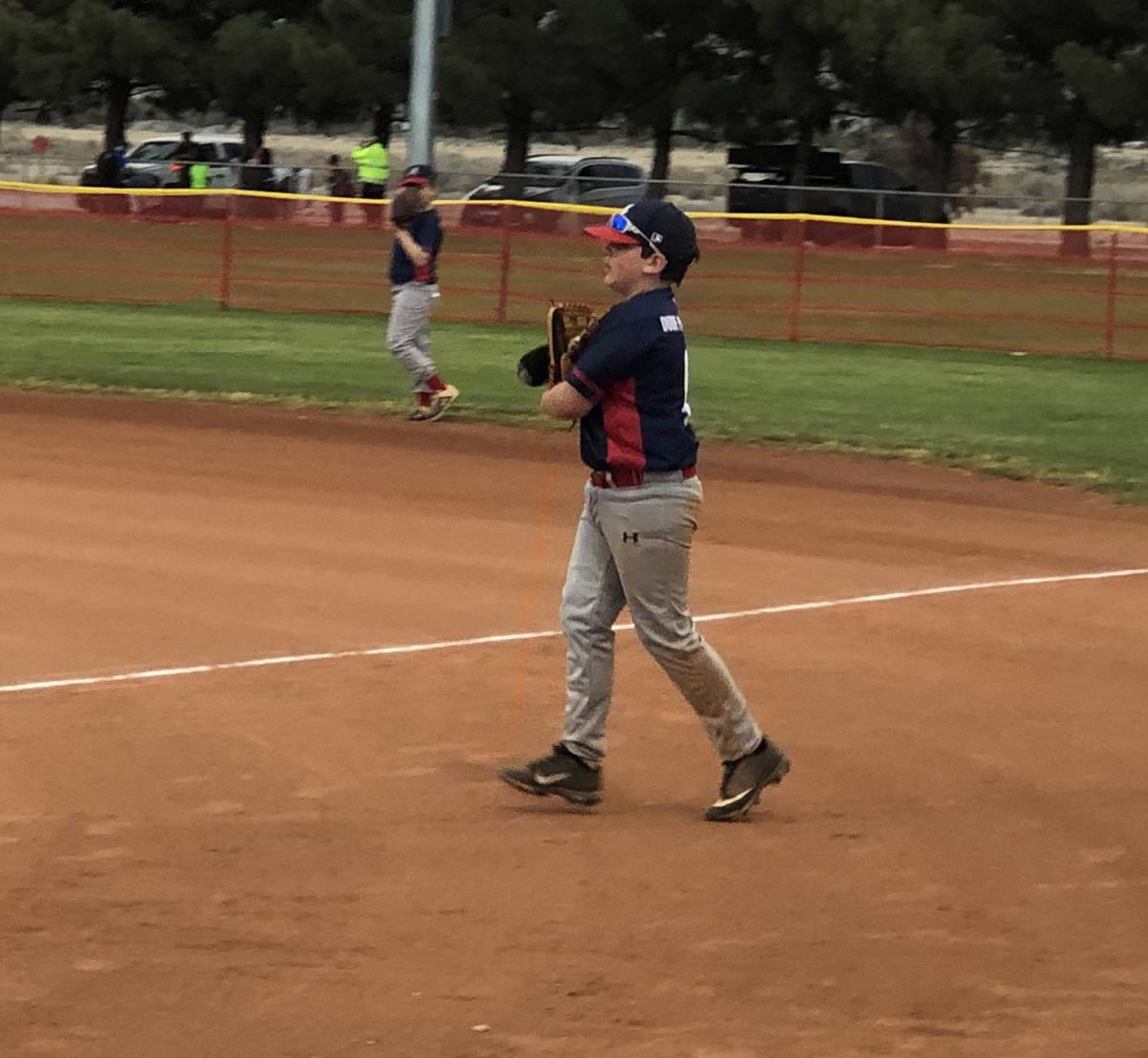 Tom Rysinski/Pahrump Valley Times Austin Abelar, 11, transfers his gloved hand into his throwin ...