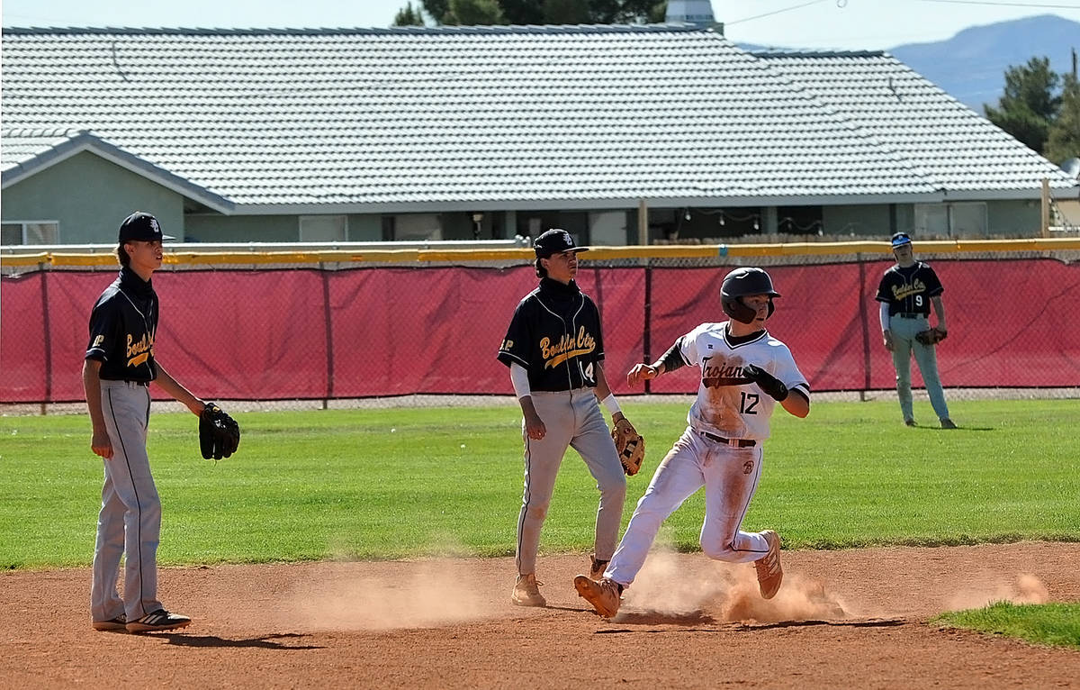Horace Langford Jr./Pahrump Valley Times Sophomore Kyle McDaniel pulls into second base on a wi ...