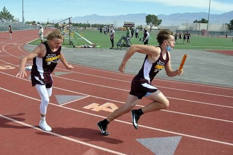 Horace Langford Jr./Pahrump Valley Times Pahrump Valley freshman Triston Church, right, takes t ...