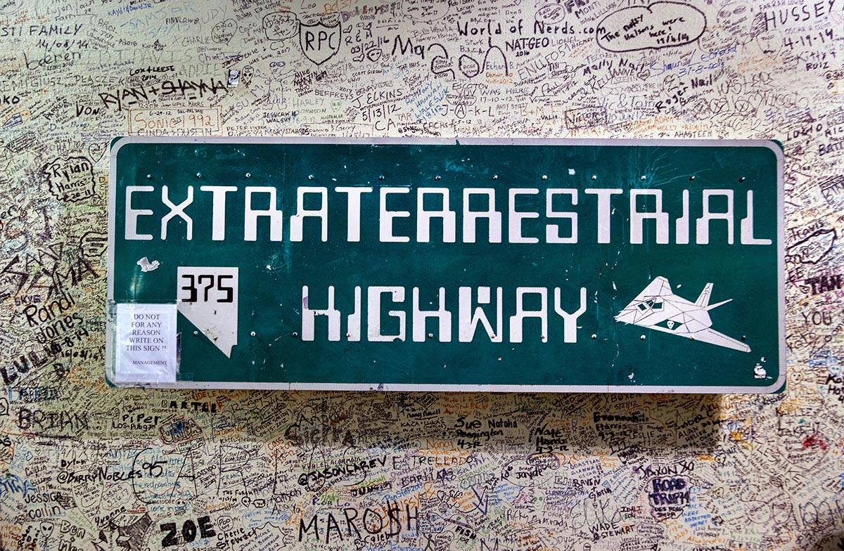 One of the Extraterrestrial Highway signs hangs about graffiti in the Alien Research Center whi ...