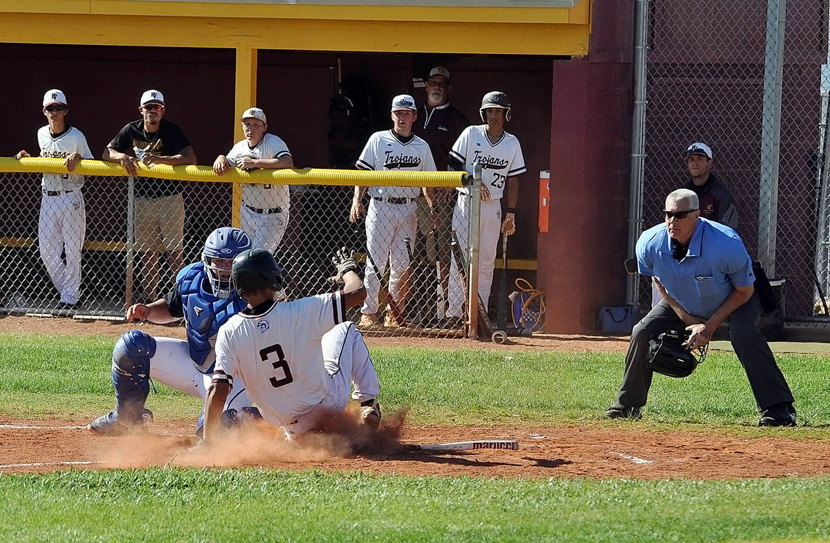 Horace Langford Jr./Pahrump Valley Times Freshman Justin Ybarra is tagged out trying to score o ...