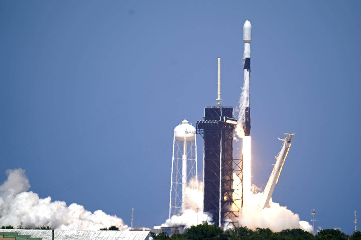 A SpaceX Falcon 9 rocket with the 26th batch of approximately 60 satellites for SpaceX's Starli ...