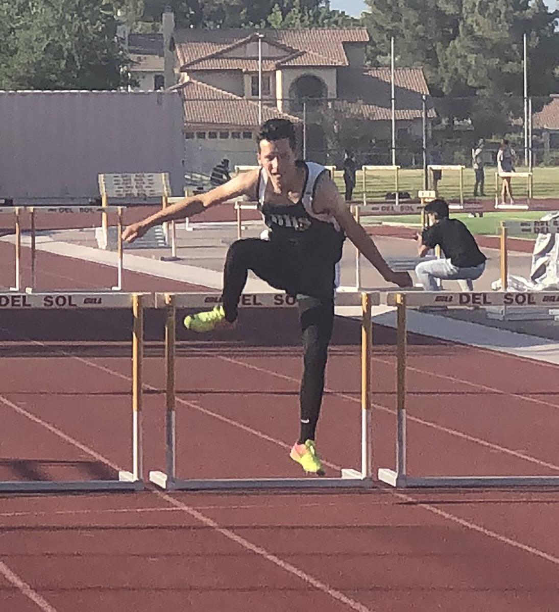 Tom Rysinski/Pahrump Valley Times Senior Noel Gutierrez clears the last hurdle during Friday's ...