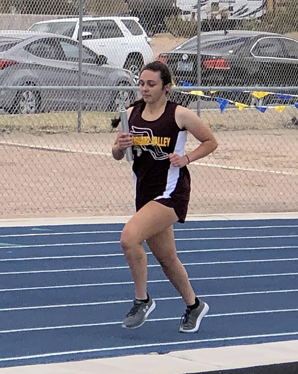 Tom Rysinski/Pahrump Valley Times Freshman Emily Lewis runs the opening leg of the 4 x 800 rela ...