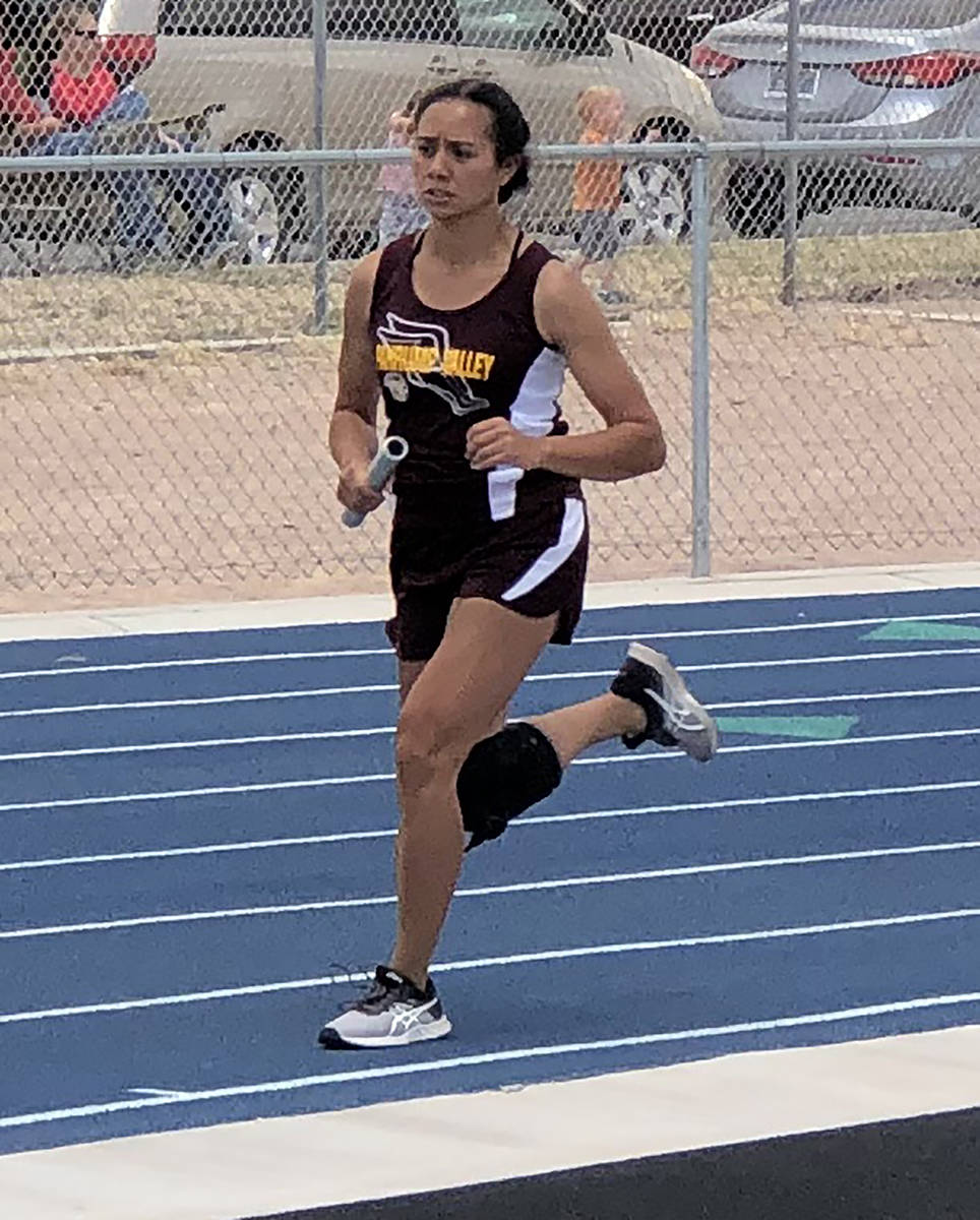Tom Rysinski/Pahrump Valley Times Junior Makani Araujo runs the third leg of the 4 x 800 relay ...