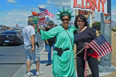 Robin Hebrock/Pahrump Valley Times Lady Liberty, aka Pamela Morgan, and Dee Mounts, along with ...