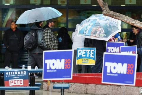 Democratic caucus-goers stand in line at the caucus site at Liberty High School on Saturday, Fe ...