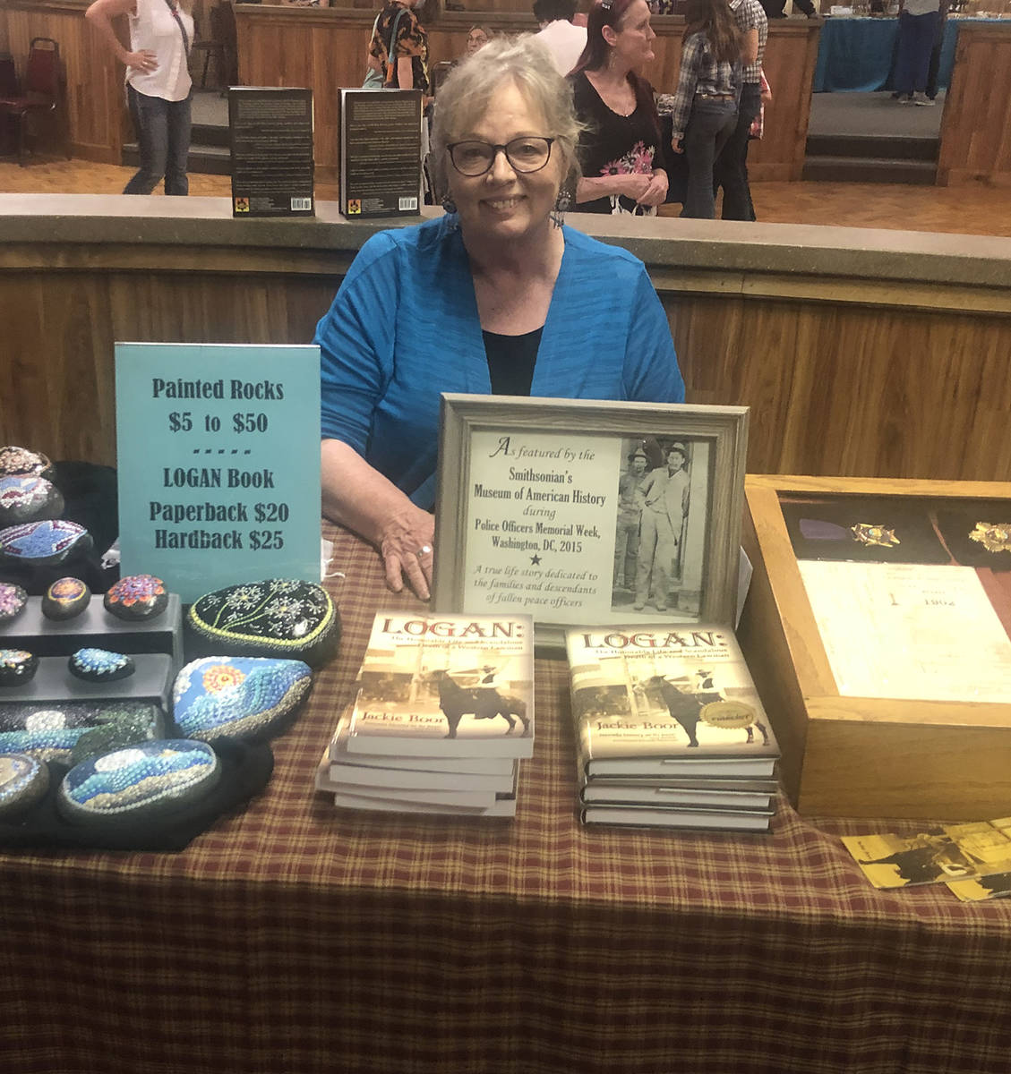 Tom Rysinski/Times-Bonanza & Goldfield News Author Jackie Boor displays copies of her book, his ...