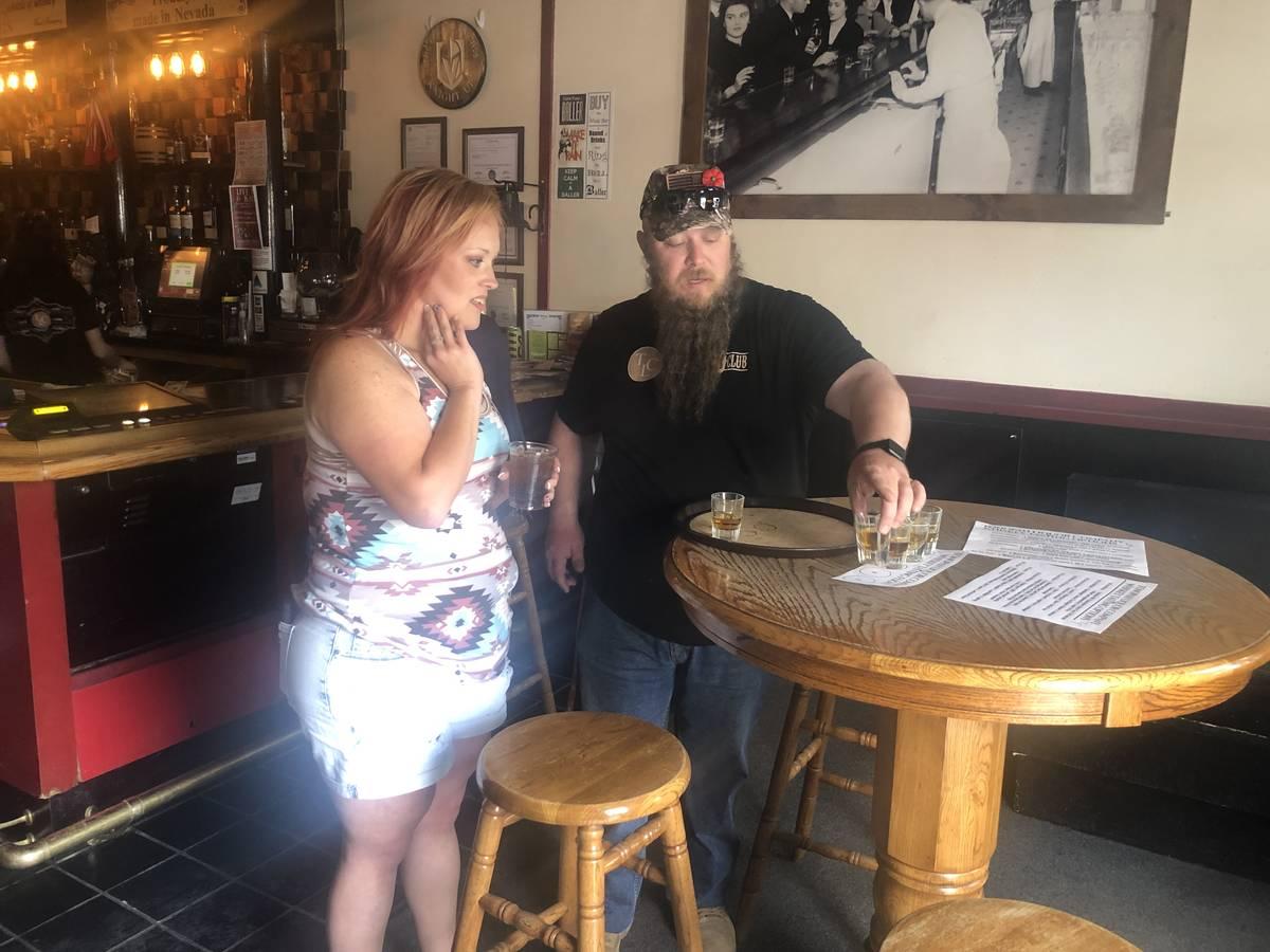Tom Rysinski/Times-Bonanza & Goldfield News Dennis Donovan pours a whiskey flight for patron He ...
