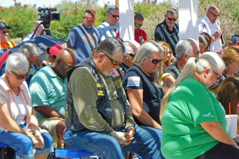 Robin Hebrock/Pahrump Valley Times Community members bow their heads in prayer during the Memor ...