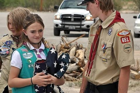 Horace Langford Jr./Pahrump Valley Times Girl Scouts and Boy Scouts helped conduct the retireme ...