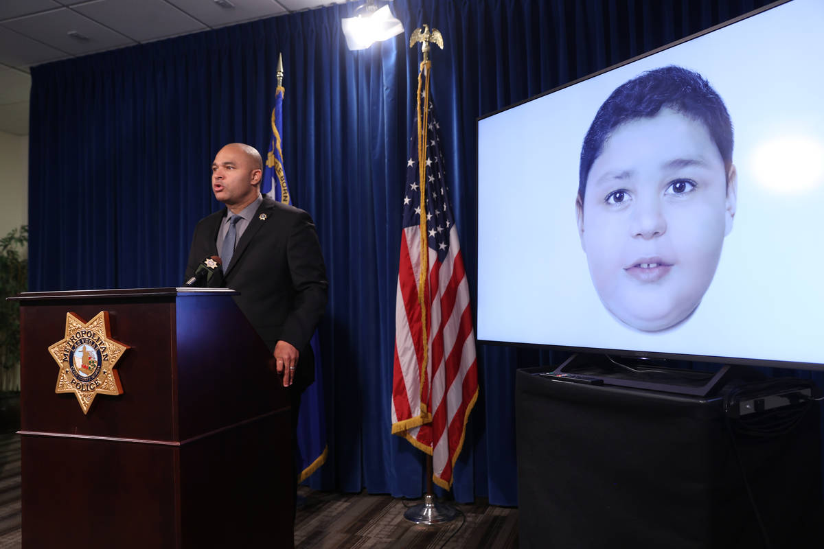 Las Vegas police homicide Lt. Ray Spencer shows a a digitally enhanced photograph of a young bo ...