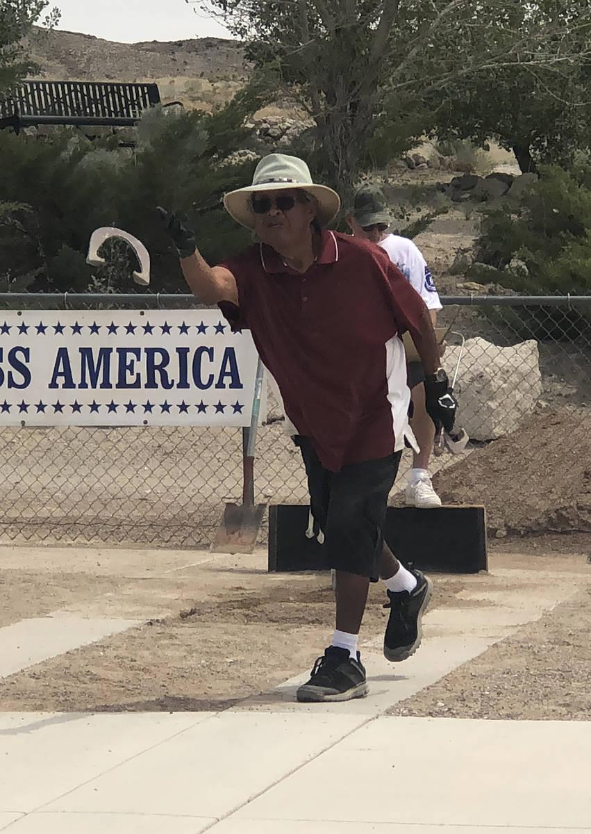 Tom Rysinski/Pahrump Valley Times Tournament host Ken Jose of Tonopah pitches a horseshoe durin ...