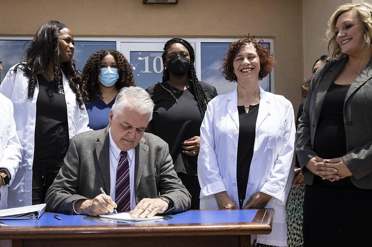Bizuayehu Tesfaye/Las Vegas Review-Journal Gov. Steve Sisolak signs Senate Bill #420, the bill ...