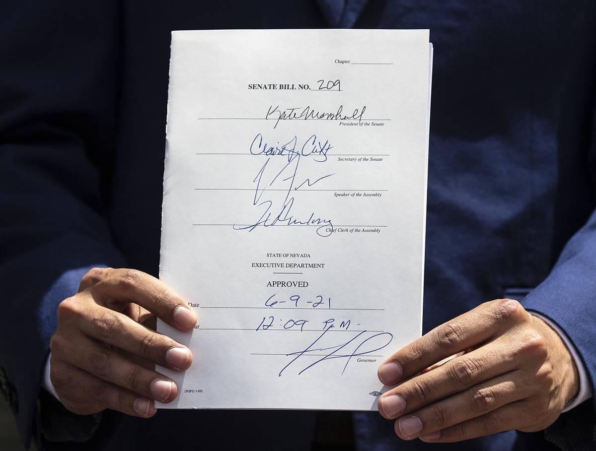 Bizuayehu Tesfaye/Las Vegas Review-Journal State Senator Fabian Donate holds Bill #209 after Go ...