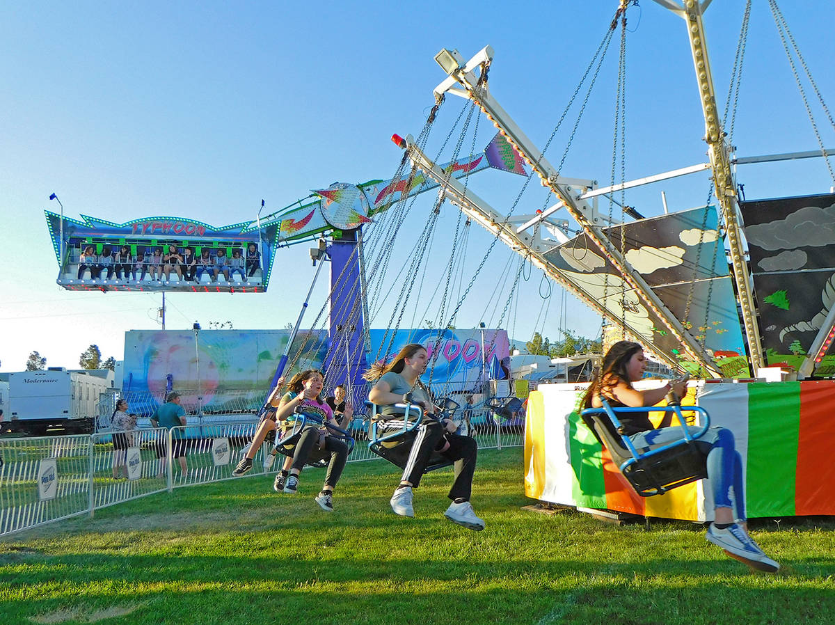 Robin Hebrock/Pahrump Valley Times Carnival-goers are pictured swinging round and round on one ...
