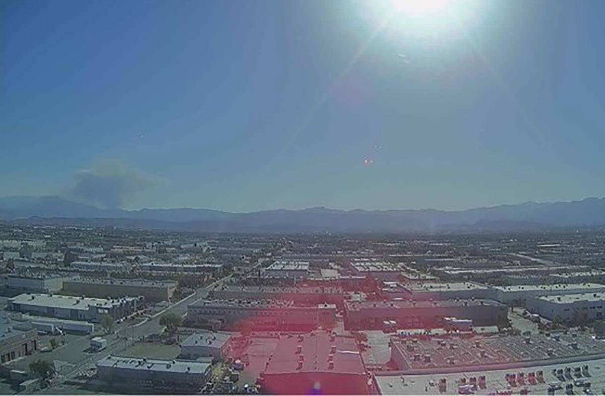 A plume of smoke rises from the Mount Potosi area as seen from a camera above Allegiant Stadium ...