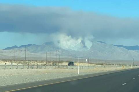 A plume of smoke rises from the Mount Potosi area. (Nye County via Twitter)