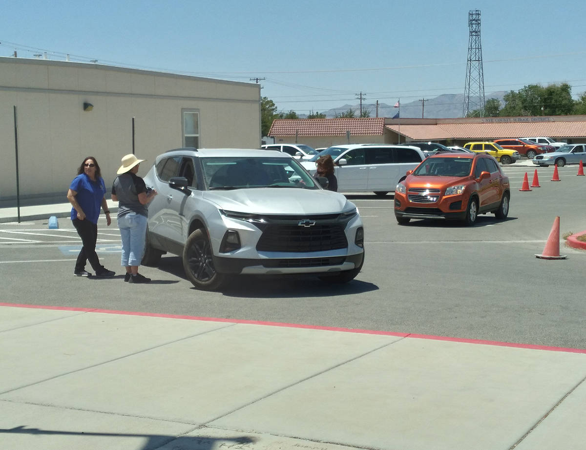 Selwyn Harris/Pahrump Valley Times More than 200 hundred families and individuals gained valuab ...