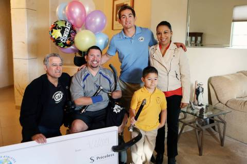 File From left, Challenged Athletes Foundation co-founder Bob Babbitt, Eddie Garcia, Paralympic ...