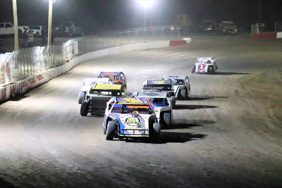 File Jared Ward leads at the head of the field during a 2020 race at Pahrump Valley Speedway. W ...