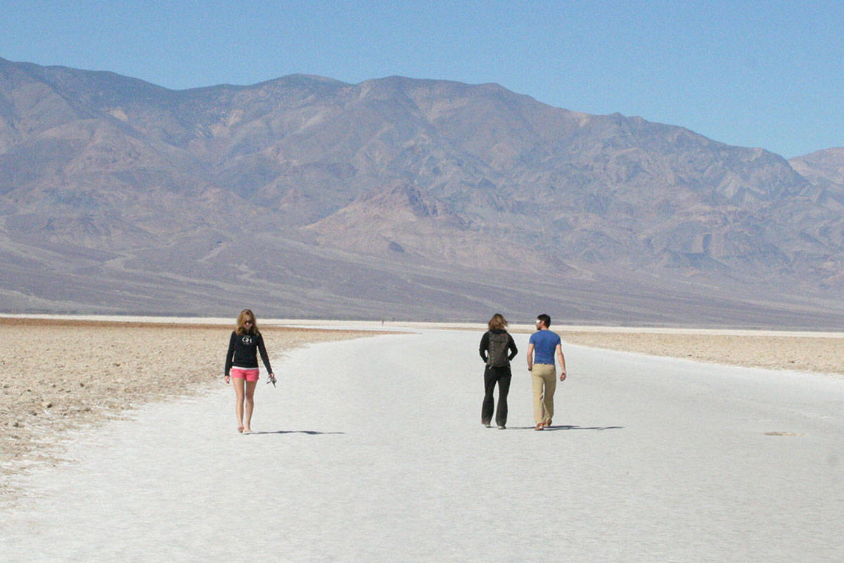 Visitors walk the salt flats at Badwater Basin in Death Valley National Park in California. (La ...
