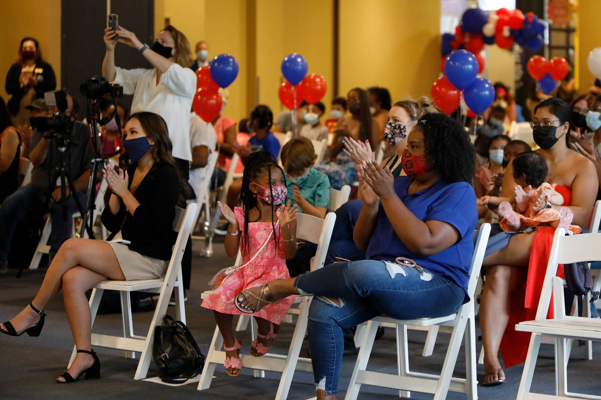 Attendees applaud during a Juneteenth celebration at the Discovery Childrenճ Museum in La ...