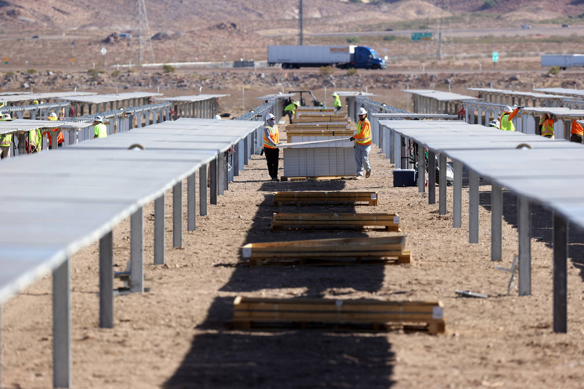 IBEW Local 357 workers install modules at Townsite solar facility in Boulder City during a visi ...