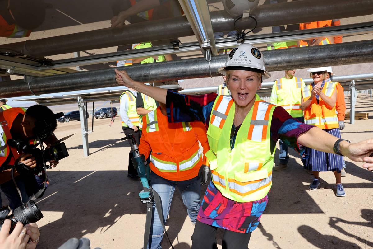U.S. Energy Secretary Jennifer Granholm celebrates after installing a module at Townsite solar ...