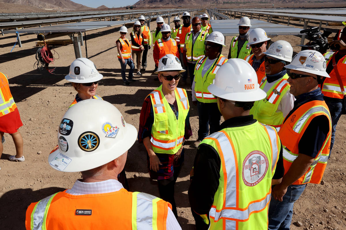U.S. Energy Secretary Jennifer Granholm, center, visits with IBEW Local 357 workers at Townsite ...
