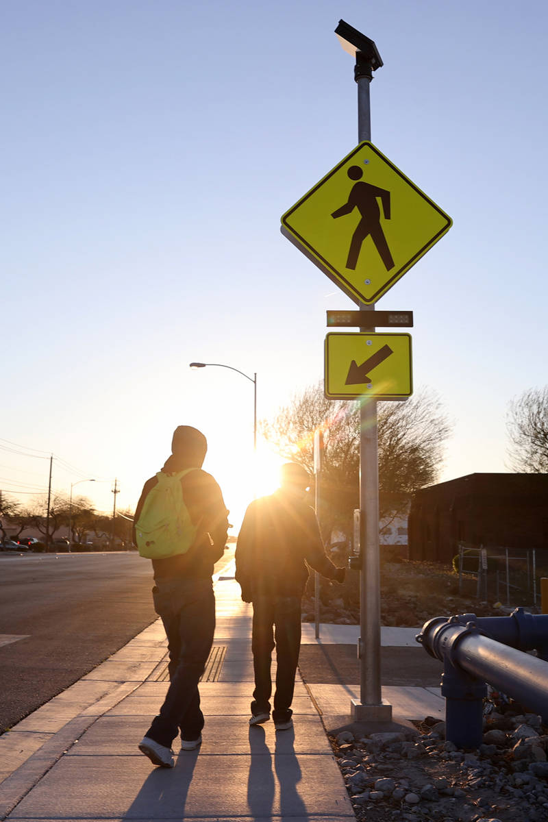 People use a crosswalk on Lone Mountain Road near Losee Road in North Las Vegas Wednesday, Marc ...