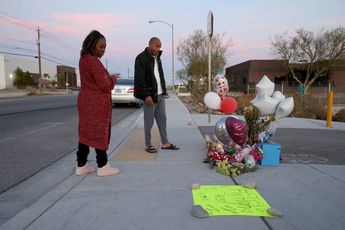 Michelle Johnson and Roy Simms of North Las Vegas pays their respects Monday, Feb. 17, 2020, at ...