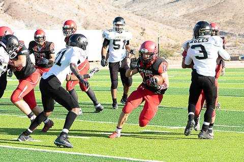 File photo Tonopah High School's Kobe Bunker looks for a hole in the Spring Mountain defense du ...