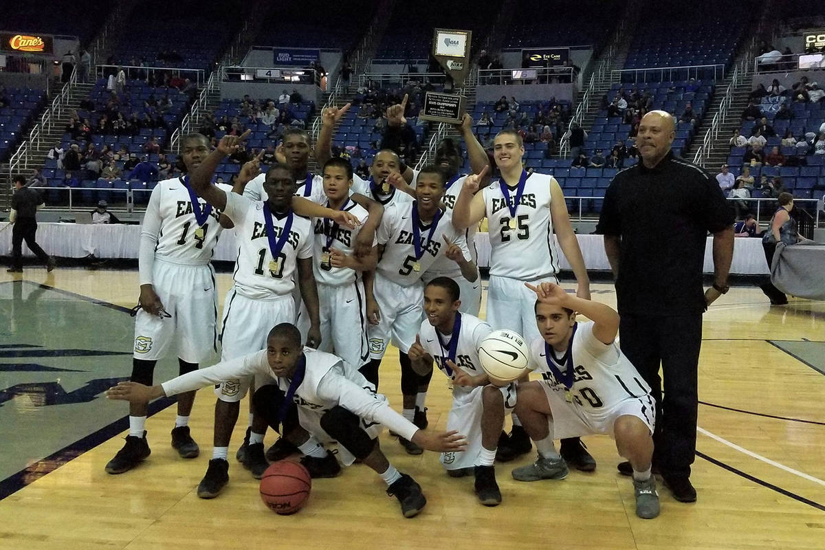 File photo Spring Mountain basketball players celebrates after winning the Class 1A state title ...