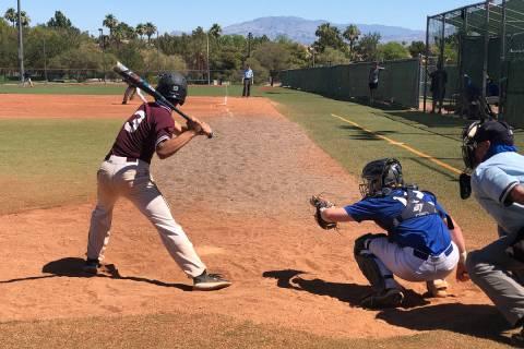 Tom Rysinski/Pahrump Valley Times Justyn Ybarra keeps his eye on a pitch that he sent to the fe ...