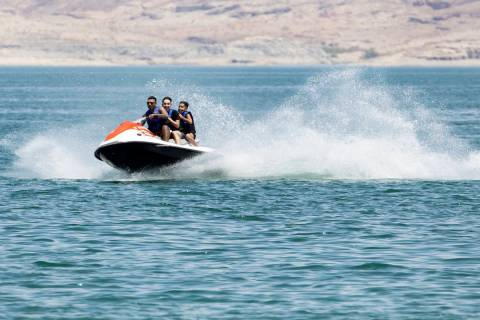 People rid their jet ski at Boulder Beach in the Lake Mead National Recreation Area, on Friday, ...